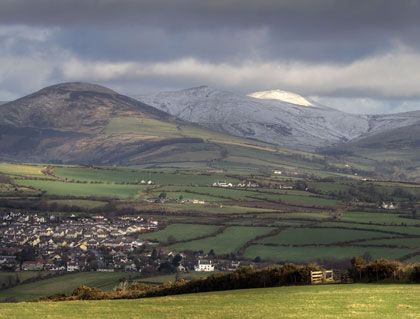 Snow covered peak of Snaefell glowing in the sun